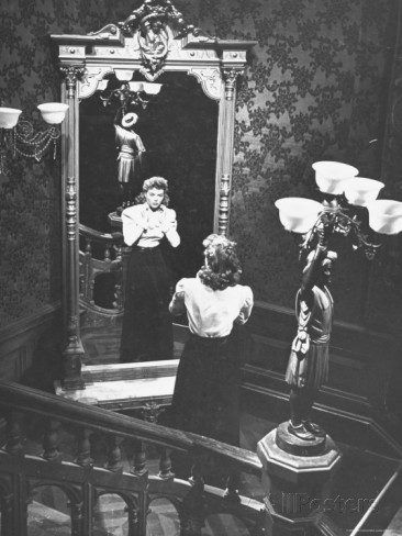 bob-landry-dorothy-mcguire-gazing-into-mirror-hands-at-throat-on-staircase-in-scene-from-spiral-staircase